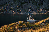 Sailboat anchorage at Buvågen bay at Helle on the westernmost tip of Moskenesøy, Lofoten Islands, Norway