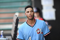 Hickory Crawdads Pedro Gonzalez (4) walks in the dugout during a game with the Asheville Tourists at L.P. Frans Stadium on May 8, 2019 in Hickory, North Carolina.The Tourists defeated the Crawdads 7-6. (Tracy Proffitt/Four Seam Images)
