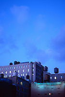 AVAILABLE FOR EDITORIAL AND COMMERCIAL LICENSING FROM GETTY IMAGES.  Please go to www.getyimages.com and search for image # a0142-000083<br /> <br /> Buildings and Iconic New York City Water Towers at Dusk in Lower Manhattan, Houston Street, New York City, New York State, USA