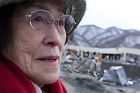 Itako Kanagawa 80 years of age and a survivor of the Hiroshima bombing  looks at tsunami damage in Kamaishi, Iwate, Japan. Thursday, March 17th 2011