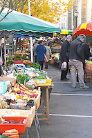 Market stalls selling fruits and vegetables. Bergerac Dordogne France