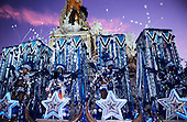 Rio de Janeiro, Brazil. Carnival; Portela float with blue and white costumes. Sapucai sambadrome (sambodromo) at dawn.