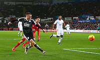 Jamie Vardy of Leicester City shoots wide from a tight angle during the Barclays Premier League match between Swansea City and Leicester City played at The Liberty Stadium on 5th December 2015