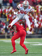 College Park, MD - NOV 12, 2016: Ohio State Buckeyes tight end Marcus Baugh (85) jumps clear over Maryland Terrapins defensive back JC Jackson (7) during game between Maryland and Ohio State at Capital One Field at Maryland Stadium in College Park, MD. (Photo by Phil Peters/Media Images International)