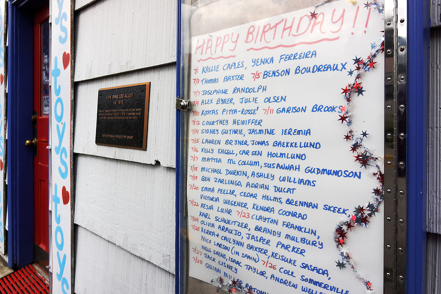 Names and birthdays of children posted outside toy store, Sing Lee Alley, Petersburg, Alaska