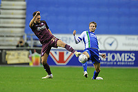 Matt Grimes of Swansea City battles with Nick Powell of Wigan Athletic during the Sky Bet Championship match between Wigan Athletic and Swansea City at the DW Stadium in Wigan, England, UK. Friday 02 October 2018