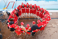 Stanford - February 1, 2015: Team huddle before the Stanford vs UCLA title match of the 2015 Stanford Invitational at Avery Aquatic Center on Sunday afternoon.<br /> <br /> The Cardinal defeated the Bruins 9-5.