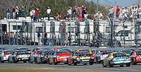 Fans standing atop their campers watch as Nextel Cup Series racers head down the backstretch at Daytona International Speedway during the Daytona 500 in Daytona Beach, Fl. (Rick Wilson/The Florida Times-Union)