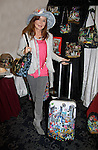 """Jacklyn Zeman """"Bobbie Spencer"""" - General Hospital shows off Jane Elissa's new luggage as she helps raise money for Leukemia and Cancer Research. (Photo by Sue Coflin/Max Photos)"""