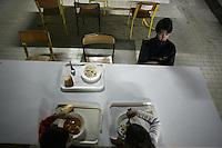 """SERBIA, Belgrade, Jan. 18, 2007..Kids eat in a shared kitchen in a refugee camp """"Krnjaca"""" near Belgrade..© Djordje Jovanovic /EST&OST"""