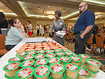 Members of the public sample vendors' wares at the Houston ISD Food Service's Nutrition Innovation Food Show at the Brookhollow Sheraton, October 24, 2013.