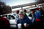 Raymond with soup donated to the campers by the 12th Street bridge near the SafeGround camp in Sacramento, Calif., January 15, 2011.