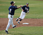 UC Davis shortstop Evan Heptig makes a play in a college baseball game against University of Washington in Davis, Ca., on Saturday, Feb. 16, 2013. Davis won the opener 6-5 and dropped the second game 3-2..Photo by Cathleen Allison