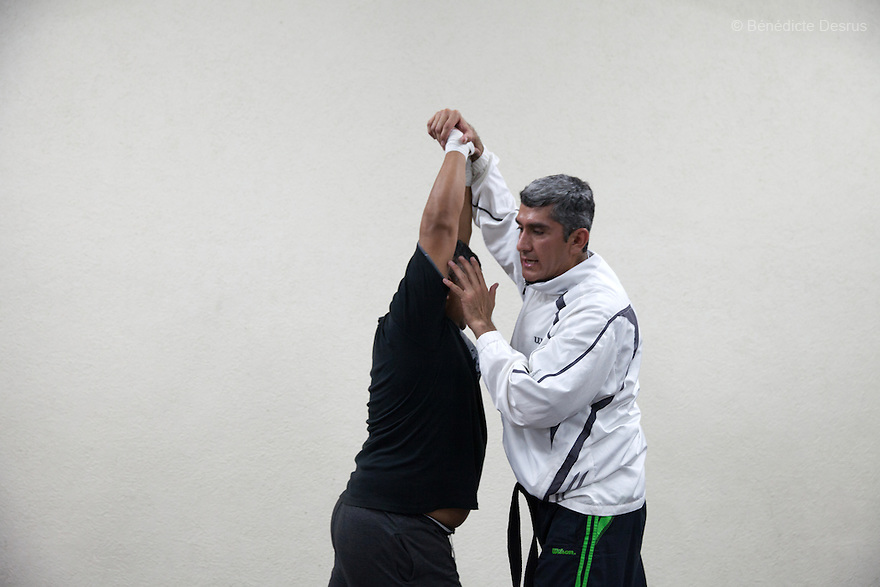 "Donovan leads a self-defense class, which he teaches three times per week, in Texcoco, Mexico on May 21, 2015. He says that the experience of teaching these classes brings him a sense of calm and order that balances out his work as a forensic cleaner. Donovan Tavera, 43, is the director of ""Limpieza Forense México"", the country's first and so far the only government-accredited forensic cleaning company. Since 2000, Tavera, a self-taught forensic technician, and his family have offered services to clean up homicides, unattended death, suicides, the homes of compulsive hoarders and houses destroyed by fire or flooding. Despite rising violence that has left 70,000 people dead and 23,000 disappeared since 2006, Mexico has only one certified forensic cleaner. As a consequence, the biological hazards associated with crime scenes are going unchecked all around the country. Photo by Bénédicte Desrus"