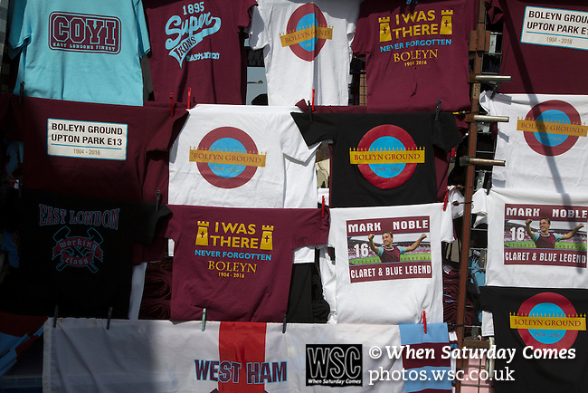 West Ham United 2 Crystal Palace 2, 02/04/2016. Boleyn Ground, Premier League. Souvenir t-shirts for sale at a stall on Green Street, close to the Boleyn Ground before West Ham United hosted Crystal Palace in a Barclays Premier League match. The Boleyn Ground at Upton Park was the club's home ground from 1904 until the end of the 2015-16 season when they moved into the Olympic Stadium, built for the 2012 London games, at nearby Stratford. The match ended in a 2-2 draw, watched by a near-capacity crowd of 34,857. Photo by Colin McPherson.