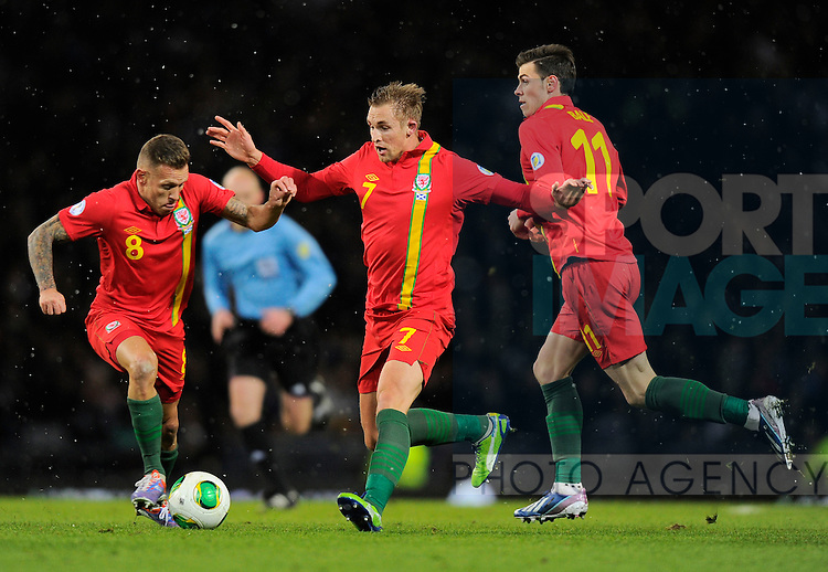 Craig Bellamy of Wales takes the ball off Jack Collinson of Wales - FIFA World Cup Qualifier 2014 Group A - Scotland vs Wales - Hampden Park Stadium - Glasgow - Scotland - 22/03/13 - Picture Simon Bellis/Sportimage-