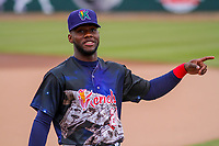 Cedar Rapids Kernels outfielder Akil Baddoo (24) talks with a fan in the stands prior to a Midwest League game against the Kane County Cougars on April 21, 2018 at Perfect Game Field at Veterans Memorial Stadium in Cedar Rapids, Iowa. Kane County defeated Cedar Rapids 9-2. (Brad Krause/Four Seam Images)