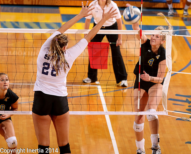 BROOKINGS, SD - SEPTEMBER 5:  Margit Hansing #4 from South Dakota State looks to get a kill down the line past Tori Bates #28 from Stephen F. Austin during their match Friday afternoon at Frost Arena in Brookings. (Photo/Dave Eggen/Inertia)