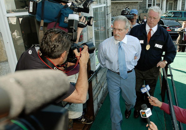 Former Pennsylvania Democratic House Whip Mike Veon, second from right, arrives in hand cuffs for his arraignment Friday, July 11, 2008, in Harrisburg, Pa. Veon and 11 others are accused of a criminal scheme to have Pennsylvania taxpayers underwrite political campaigns. Police officer at right is unidentified. (AP Photo/Bradley C Bower)