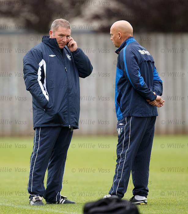 Ally McCoist on his phone during training