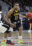 OMAHA, NE -- February 10th, 2016 -- George Marshall #11 of South Dakota State passes the ball off at mid court while being defended by Devin Patterson #3 of the University of Nebraska Omaha during their game Wednesday evening at Baxter Arena in Omaha, NE. (Photo By Ty Carlson/Inertia)