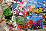 Packets of brightly coloured Unwins flower plant seeds