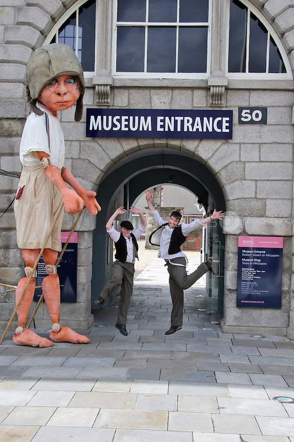 10/09/'10 Macnas performers pictured with a 15 foot high 8 year old boy explorer puppet at The National Museum of Ireland, Collins Barracks this afternoon as they prepare for the Saturday opening spetacular Absolut Fringe 16th Annual Fringe Festival. The free show opens tomorrow night at Collins Barracks at 8pm and runs until the 26th Sept..Picture Colin Keegan, Collins, Dublin.