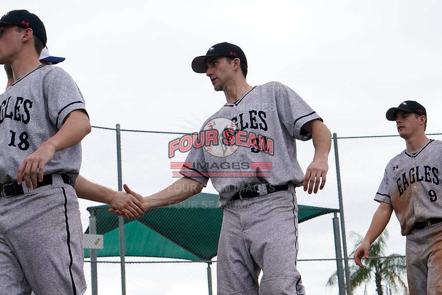 Edgewood Eagles Richie Coughlin (31) shakes hands after the second game of a double header against the Bethel Wildcats on March 15, 2019 at Terry Park in Fort Myers, Florida.  Bethel defeated Edgewood 3-2.  (Mike Janes/Four Seam Images)