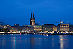 The Rathaus and buildings at night time on the lake Binnenalster Hamburg, Germany