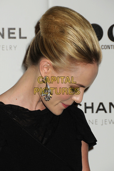 "KATE BOSWORTH .attending MOCA's Annual Gala, ""The Artist's Museum Happening"", Sponsored by Chanel Fine Jewelry, held at MOCA Grand Avenue (Museum Of Contemporary Art) in Los Angeles, California, USA, November 13th 2010. .portrait headshot hair up black earrings silver profile side beehive looking down .CAP/ADM/BP.©Byron Purvis/AdMedia/Capital Pictures."