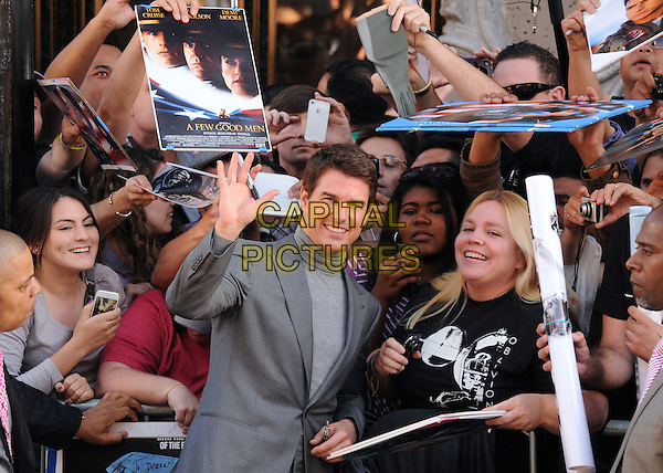 "Tom Cruise.""Oblivion"" Los Angeles Premiere held at the Dolby Theatre, Hollywood, California, USA..April 10th, 2013.half length grey gray turtleneck polo neck high collar suit fans crowd signing autographs hand waving palm warm .CAP/ADM/BP.©Byron Purvis/AdMedia/Capital Pictures."