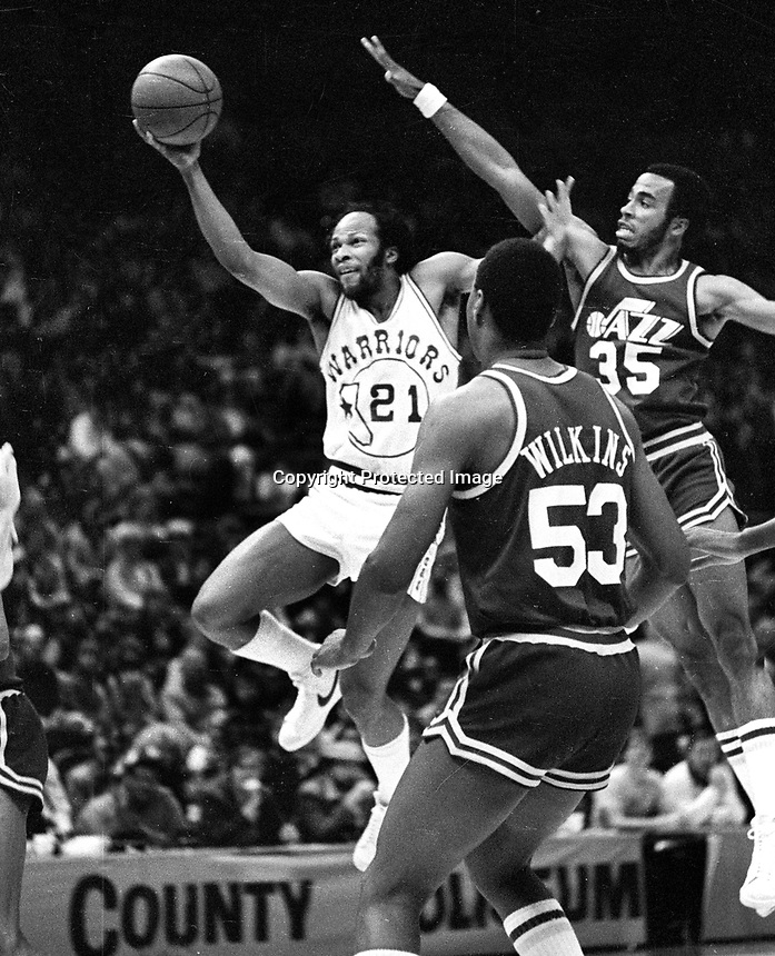 "Warriors Lloyd ""World"" Free shooting against Jazz Darrell Griffith and Wilkins.<br />