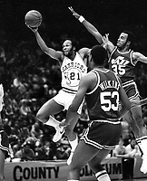 Warriors Lloyd &quot;World&quot; Free shooting against Jazz Darrell Griffith and Wilkins.<br />