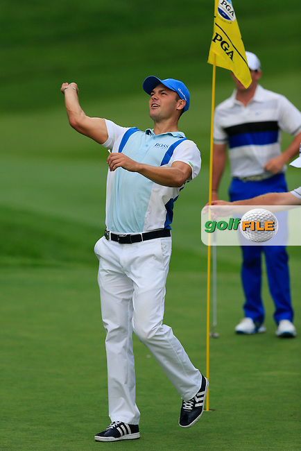 Martin Kaymer (GER) throws his ball to the gallery at the 13th green after holing his 2nd shot during Thursday's Round 1 of the 95th US PGA Championship 2013 held at Oak Hills Country Club, Rochester, New York.<br /> 8th August 2013.<br /> Picture: Eoin Clarke www.golffile.ie