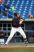 Quad Cities River Bandits shortstop Kristian Trompiz (13) squares to bunt during the first game of a doubleheader against the Wisconsin Timber Rattlers on August 19, 2015 at Modern Woodmen Park in Davenport, Iowa.  Quad Cities defeated Wisconsin 3-2.  (Mike Janes/Four Seam Images)