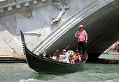 People taking a gondola ride on the Canal Grande (Grande Canal) near the Rialto Bridge in Venice, Italy from a water taxi in the middle of the Canal Grande (Grand Canal) during the noon hour on Sunday, May 27, 2018.<br /> Credit: Ron Sachs / CNP