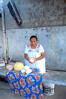 Woman age 74 making bread.  Cozumel   Mexico