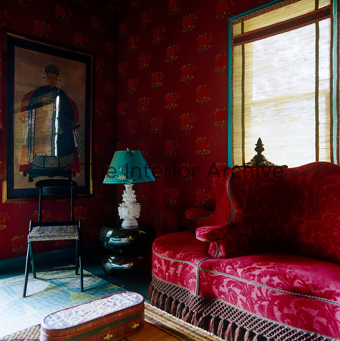Muriel Brandolini's fabrics brighten the walls of the guest cottage and give it a rich Oriental theme