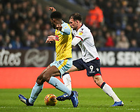 Bolton Wanderers' Christian Doidge competing with Rotherham United's Semi Ajayi<br /> <br /> Photographer Andrew Kearns/CameraSport<br /> <br /> The EFL Sky Bet Championship - Bolton Wanderers v Rotherham United - Wednesday 26th December 2018 - University of Bolton Stadium - Bolton<br /> <br /> World Copyright © 2018 CameraSport. All rights reserved. 43 Linden Ave. Countesthorpe. Leicester. England. LE8 5PG - Tel: +44 (0) 116 277 4147 - admin@camerasport.com - www.camerasport.com