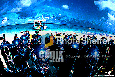 Grand Cayman Island, British West Indies - A barge-type dive boat is ready to accept passengers early in the morning prior to a beach departure on Seven Mile Beach. The aluminum tanks, filled with compressed air, are waiting to be loaded abord and will provide the Scuba divers with hours of undersea exploration on the reefs below.<br /> <br /> LOW-REZ ONLINE ONLY<br /> <br /> Original slide or a high-resolution scan available upon request.<br /> <br /> Ed Wolfstein Photo