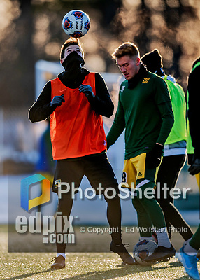 13 November 2019: Members of the University of Vermont Catamounts warm up in below freezing temperatures prior to the America East Semi-Final game against the University of Hartford Hawks at Virtue Field in Burlington, Vermont. The Catamounts fell to the visiting Hawks 3-2 in sudden death overtime of the Division 1 Men's Soccer matchup. Mandatory Credit: Ed Wolfstein Photo *** RAW (NEF) Image File Available ***