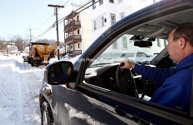 Waterbury, CT- 10 February 2013-021013CM07-  Mayor Neil M. O'Leary checks on a city plow truck that got stuck on Division Street in Waterbury Sunday morning.  The Mayor and his staff were driving  around the city assessing the road conditions as the city continued to dig themselves out after a blizzard dumped more than two feet of snow in the area.   Christopher Massa Republican-American