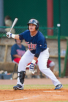 Oswaldo Arcia #24 of the Elizabethton Twins follows through on his swing against the Kingsport Mets at Joe O'Brien Field August 14, 2010, in Elizabethton, Tennessee.  Photo by Brian Westerholt / Four Seam Images