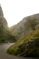 A car drives through Cheddar Gorge, Cheddar, UK, October 16, 2017. Spectacular Cheddar Gorge features the highest inland cliffs in the UK. The nearby village of Cheddar is also the birthplace of the eponymous cheese.