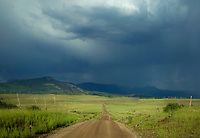 A ark storm passes through the pastures at Kolob Terrace adjacent to Zion National park, Utah