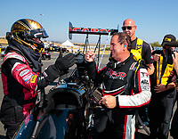 Jul 28, 2019; Sonoma, CA, USA; NHRA top fuel driver Billy Torrence (right( is congratulated by runner up Clay Millican as he celebrates after winning the Sonoma Nationals at Sonoma Raceway. Mandatory Credit: Mark J. Rebilas-USA TODAY Sports
