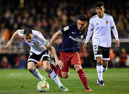 06.03.2016. Mestalla Stadium, Valencia, Spain. La Liga match between Valencia versus Atletico Madrid. Midfielder Javi Fuego of Valencia CF (L) takes on Midfielder Kranevitter of Atletico Madrid (C)