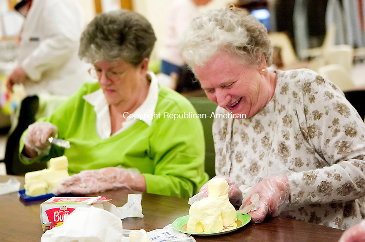 OXFORD, CT- 29 MARCH 07- 032907JT11- <br /> Jeanette Laird, right, and June McDonald sculpt lambs out of butter at the Oxford Senior Center on Thursday morning. Though initially made as a decoration, the lambs can be used to flavor food during Easter dinner.<br /> Josalee Thrift Republican-American
