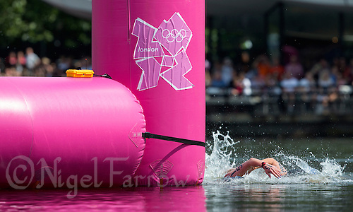 09 AUG 2012 - LONDON, GBR - Keri-Anne Payne (GBR) of Great Britain leads competitors round a turn buoy during the London 2012 Olympic Games women's 10km Marathon Swimming in Hyde Park, London, Great Britain (PHOTO (C) 2012 NIGEL FARROW)