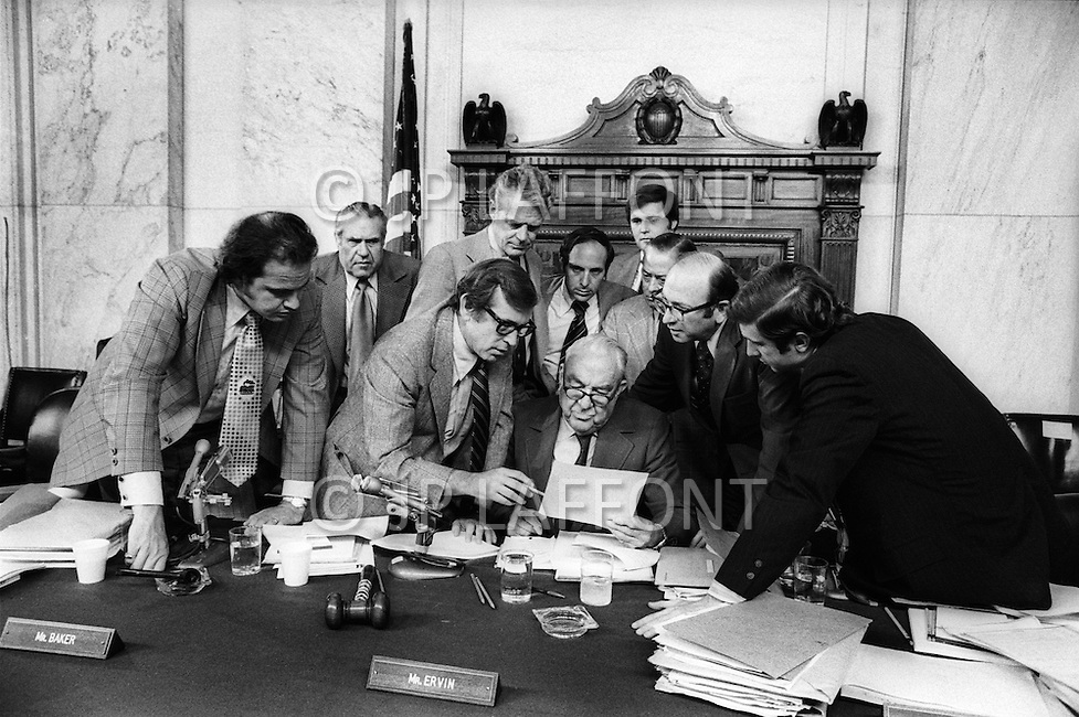 Washington DC. August 9th, 1974. <br /> (l to r) Fred Thompson, Howard Baker, Edward Gurney, Sam Erwin (seated center) Samuel Dash, unidentified far left) in a discussion. A break in at the Democratic National Committee headquarters at the Watergate complex on June 17, 1972 results in one of the biggest political scandals the US government has ever seen. Effects of the scandal ultimately led to the resignation of  President Richard Nixon, on August 9, 1974, the first and only resignation of any U.S. President.